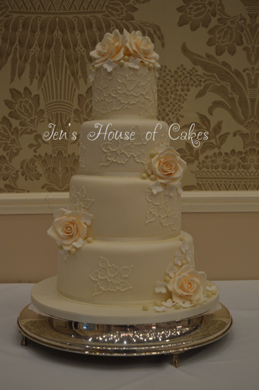 Brush Embroidered Wedding Cake With Delicate Sugar Flowers